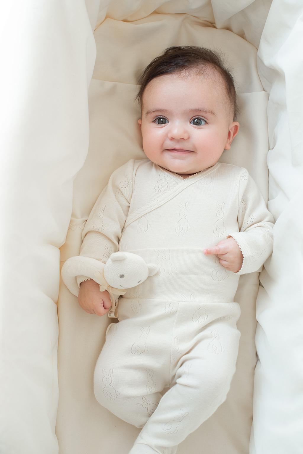Bodysuit with bunnies made in a wrap-over style.